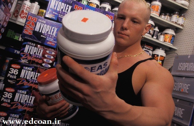 Man Reading Supplement's Ingredients